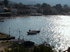 Sparkling Water (sanDr.a.92) Tags: sea shore bay boat water sun reflection afternoon sunset coast beach boats outside outdoor view
