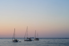 St Eulalia Sunrise (1/3) (ollietat) Tags: sunrise santaeulalia nikon d300 ocean sea boats horizon calm ibiza spain water sailing beach