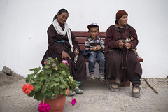 At Leh (Ravikanth K) Tags: 500px leh people culture buddhists monastery ladakh travel bench kid women outdoor prayer flowers pot portrait casual clothing