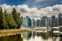 Lord Stanley's Playground ( ) Tags: vancouver stanleypark canada bc water city clouds sea architecture trees light beach ocean blue green beautiful cityscape