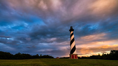 Sunset Storms At Hatteras (Travis Rhoads) Tags: 2016 sonyilce7rm2a7rii zeissbatis18mmf28 clouds coastal landscapephotography lighthouse nikcollectionbygoogle sunset copyright2016 travisrhoadsphotography weather stormclouds storms northcarolina theouterbanks capehatteraslighthouse capehatterasnationalseashore hatterasisland obx goldenhour thegoldenhour