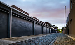 Measures at Dawn (Dr Abbate) Tags: street sky house architecture modern night dawn vanishingpoint alley cloudy garage parking rear perspective australia victoria cobblestone lane residential bluestone brunswickeast
