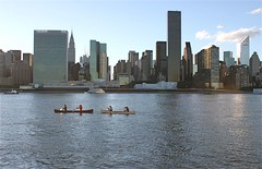 Sunday Evening (Paul DeSilva) Tags: nyc newyorkcity urban panorama ny newyork water skyline architecture buildings reflections river evening boat cityscape skyscrapers manhattan towers paddle canoe adventure midtown queens unitednations highrise eastriver rowing oar serene ripples tandem chryslerbuilding distance picturesque longislandcity hirise waterreflections midtowneast gantryplaza