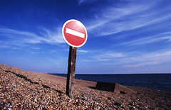 Obstruction... (Trapac) Tags: ocean uk blue red sea summer england white signs film beach sign coast nikon fuji horizon shingle rules slidefilm unescoworldheritagesite stop single dorset 100 noentry positive analogue f80 nikkor expired barriers chesilbeach 2012 sensia lowangle nikonf80 fujisensia jurassiccoast wmh chesilbank 50feethigh barrierbeach westbexington nikkor1835mm 29kmlong
