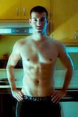 Express (Stephanie Wesolowski) Tags: blue shirtless motion black blur male kitchen fashion photoshop pose buzz model shadows pants ripped cyan indoor noflash stove owl editorial express retouch abs chiseled