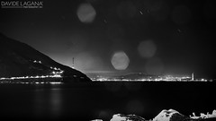 Lacrime (Davide Laganà · digital artist) Tags: longexposure sea canon eos lights star mare trail sicily luci scilla calabria strait sicilia messina stelle 500d stretto scia cariddi esposizionelunga canonefs1855mmf3556is