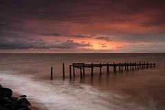 New day (Explored) (Steven Docwra) Tags: longexposure sea beach clouds sunrise coast rocks waves cloudy horizon norfolk northsea groyne corton stevedocwra