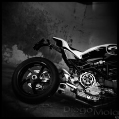 Ducati Ms4R by Paolo Tex (pellicola) (Diego Mola) Tags: ducati ms4r paolotex paolo tex tesio holga trix tri x tx biker moto diegomola bikerlife pirelli bn black white bianco nero kodak speed photo picture motorcycle bike motor analogico analogique analogica film blackwhite bw toy camera analog analogue photography square vignetting mola diego helmet light luce riflesso reflection sbaffo smudge sport casco life tuning restyling new style s4 s4r qd exaust testastretta monster 996 996cc naked toycamera 1000 scansione analogic analogicas special