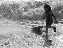 The Scream (Wilamoyo) Tags: sea bw white black beach water girl female fun droplets surf waves child little tide spray sprinkles scream