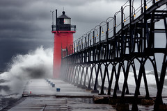 South Haven (The New No. 2) Tags: old autumn light red sea sky cloud lighthouse white seascape storm color fall beach nature water weather clouds mi danger dark landscape flow coast pier big october marine energy rocks day waves power unitedstates wind cloudy outdoor michigan tide horizon hurricane lakes dramatic wave stormy gale spray historic lakemichigan shore maritime disaster coastline nautical heavy beacon climate 2012 calamity southhaven catastrophe stjoeseph johncrouch copyrightjohncrouch johncrouchphotography crouchphotos