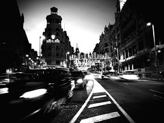 Spain, Madrid, Gran Via,  18:30 h. (Zdravko Petrov) Tags: madrid plaza city houses urban white house black color colour building history cars blanco luz girl beauty car night buildings way photography lights luces noche grande avenida calle spain farola europa europe cityscape nocturnal watches path capital watch negro great transport ciudad olympus palace best via espana ventanas cameras coche gran metropolis urbano capture avenue scape guapa farolas fachada comunidad coches telefonica belleza transporte palacio publico  guapas spagne objetivos 450e