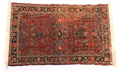 75.  Persian Sarouk Area Rug