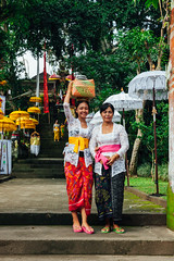 Young woman with her mother (Evgeny Ermakov) Tags: old travel family decorations red people bali woman white holiday tourism senior colors beautiful beauty smile fashion yellow indonesia asian religious temple holidays colorful asia southeastasia hand basket rice head traditional religion daughter decoration young mother ceremony culture style newyear clothes celebration exotic silence destination ritual southeast cultures carry ubud carrying balinese nyepi dayofsilence silenceday carryonhead carryingonhead editorialuse