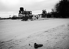 "they got their ""kicks"" on old route 66... (BillsExplorations) Tags: route66 motherroad highway historic california essex ghosttown abandoned decay forgotten shutdown shuttered kicks shoes blackandwhite monochrome desert discarded"