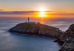 Southstack sunset (Anthony White) Tags: northwales uk gb sunset southstack lighthouse sunburst rocks nopeople ocean longexposure natur nature seascape bridge