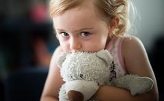 Blue Eyes (Mike Brnnimann) Tags: girl kid teddy cuddling blond young bokeh 85mm nikkor nikon d800 sunlight