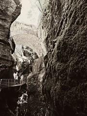 Gorges du Fier (AmyEAnderson) Tags: gorge cliffs bridge footpath footbridge shadows monochrome sepia france europe spring rhonealps