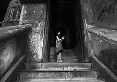 the girl next door (AanupamM) Tags: girl outdoor blackandwhite people travel kolkata street wide canon