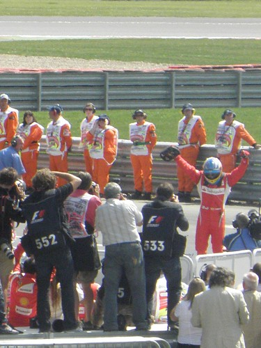 Fernando Alonso celebrates winning the 2011 British Grand Prix at Silverstone