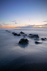 Sunset (Tommaso Petruzzi ) Tags: long exposure sunset sky sun sea rocks nd8 nikon italy europe rome mediterraneo tirreno mare roma ostia spiaggia sand beach rocce scogli italia europa filtro lunga esposizione cielo tramonto nuvole clouds colori blu rosso 16mm lazio estate autunno alba
