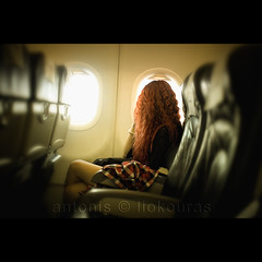 The girl in my flight (Antonis Liokouras) Tags: trip travel vacation woman color window girl horizontal comfortable digital airplane photography chair europe publictransportation looking photos flight lifestyle photograph transportation passenger relaxation oneperson caucasian lookingthrough lookingthroughwindow nikond700