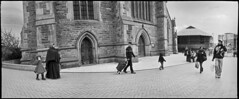 Walking the Walk [9] (*monz*) Tags: street blackandwhite bw woman man streets film church st shopping birmingham pavement iso400 trolley hijab 11 selfridges widelux hp5 swinglens martins ilford brum 20c xtol f7 12m 26mm monz panon autaut