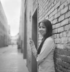 Sachiko, Stranger #59 (Andy Kennelly) Tags: old bw film zeiss town back alley break fuji bricks stranger smoking hasselblad carl medium format 100 waitress 50 sachiko acros