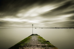 The pier (Explored) (Scott Baldock Photography) Tags: uk light sunset sea england blackandwhite bw seascape storm colour london beach sepia landscape boats grey mono bay coast pier boat seaside moss long exposure angle jetty low wide estuary east thorpe daytime algae longest leigh essex leighonsea tone southend shoeburyness selective lightroom southendonsea eastbeach lifeboats southchurch chalkwell shoebury blackwhitephotos prittlewell nd110