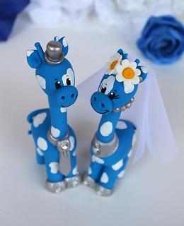 Giraffe wedding cake topper in blue and white