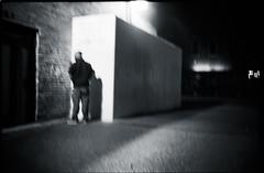 Oakland, pissing (icki) Tags: ca blackandwhite man station night dark oakland alone uptown peeing 19thbart