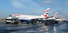 A wet, but sunny, day at London City Airport (kitmasterbloke) Tags: wet ramp sunny aeroplane britishairways airliner londoncityairport embraer emb170 lcy glcyd