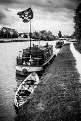 Canal pirates (Capture the planet) Tags: fx d810 fullfame nikon nikkor photography flickr bw blackandwhite monochrome blackwhite tonal contrast photographer photograph 35mmf14g narrowboat canal water jollyroger skullandcrossbones pirate pirates fav10 fav25