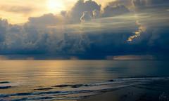 Drama in the sky (Arek Adeoye) Tags: clouds sky sea beach seascape goldenhour bali indonesia dramaticclouds