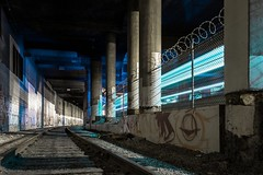 Train trails (JayCWSee) Tags: urban street abandoned station vancity neon blue dark painting light underground tunnel tracks train vancouver