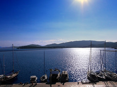 Volos port (Geo.M) Tags: city morning blue sea sky sun beach beautiful clouds port boats early george seaside day sailing view sunny giorgos the volos   limani   ouranos        miliokas synnefa istiofora