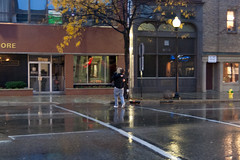 A proposal? (bill.d) Tags: street people woman usa man fall wet rain outside outdoors evening streetlight michigan unitedstatesofamerica firehydrant kalamazoo asphalt embrace raining carrying wetasphalt xti worldwidephotowalk kelbyphotowalk scottkelbyworldwidephotowalk