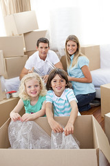 Smiling family packing boxes (afmejiac) Tags: new family light boy house cute home parenthood girl childhood laughing children moving child realestate floor flat little box sister brother empty room father daughter mother adorable son indoor glad cardboard jubilant boxes merry sibling jolly cheerful joyful elated offspring overjoyed joyous thrilled pleased homeowner gleeful delighted blissful chirpy upbeat