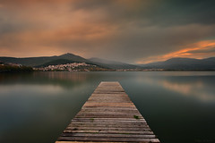 Until the dark (Nick-K (Nikos Koutoulas)) Tags: sunset lake rain club clouds pier calm nautical  kastoria