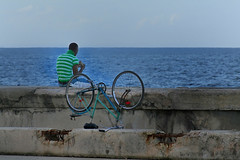 Taking a break.. (areyarey) Tags: ocean road park street city travel sea summer green classic beach sports bike bicycle wheel relax outside happy bicycling cycling coast seaside sitting break cyclist view upsidedown wheels transport havana cuba atlantic chain riding health shore cycle transportation biking promenade sit malecon vehicle classical rest biker bicyclist caribbean summertime parked recreation activity cuban fitness atlanticocean enjoyment embankment upside pedal tyre active malecn overturned traveler overturn relaxes cycler exercising healthiness areyarey