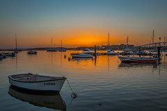 Tranquility (Artur Tomaz Photography) Tags: tranquility alvor bay boat bridge coast dock marina orange sea sunset water summer yellow ship blue