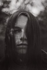 S P O O K Y (theelectricmango) Tags: foggy mysterious dark moody squawpeak portrait woods eyes modeling hair halloween filmsnotdead analogue bokeh cookingupfilm film caffenol model spooky forrest wideopen 50mm kentmere100 blackwhite f3 nikon