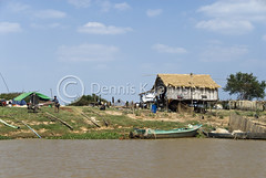 Farmers work their fields near Tonle Sap Lake. (dkjphoto) Tags: travel lake fish tourism home water field river boat fishing asia cambodia seasia cambodian tour village farm tourist farmer siemreap stilt raised tonlesap
