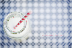 Milky (| Les Hirondelles |) Tags: above italy stilllife food white blur glass childhood closeup breakfast canon children milk bottle colorful europe soft break child cloudy drink bokeh pastel background stripes softness beverage straw blurred fromabove pale health dreamy copyspace latte pure milky foodanddrink cibo merenda pureness healthyfood redandwhite blueandwhite selectivefocus checked bevanda 100mm28 stripedstraw candour pastelcolors hbw extremebokeh igp bottleofmilk 5dmarkii leshirondellesphotography redandwhitestripedstraw strawinmilk