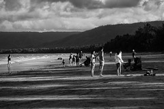 Tropical Heat at 4.30pm (Julie Byrnes) Tags: light blackandwhite bw beach shadows noiretblanc candid australia portdouglas lateafternoon streetimages beachproject juliebyrnes