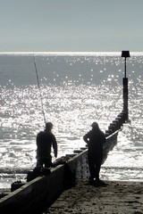 Fishing for a shot. (Mike-Lee) Tags: reflection mike sunshine seaside glare jill bournemouth intothesun oct2012