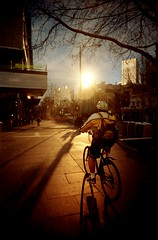 the sun from the south (mugley) Tags: road street city morning people urban sun sunlight trafficlights colour reflection tree film bike architecture sunrise 35mm buildings walking concrete dawn vanishingpoint cityscape glare cyclist kodak pavement branches ghost helmet grain australia melbourne wideangle victoria scan sidewalk crappycam riding negative tiles backpack flare pedestrians epson sunburst cbd backlit 135 footpath bins commuters eurekatower urbanlandscape swanstonst qv longshadows c41 22mm v700 kodakgold400 gold400 vivitarultrawideandslim wideslim eximus eximuswideandslim