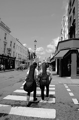 Walk the Line. (Elliot.Hall) Tags: life street summer sky cloud white london composition out lights is photo nikon gate shoes crossing angle guitar britain streetlights jubilee hill wide there acoustic british law summertime cloudless nikkor notting 18mm blakc
