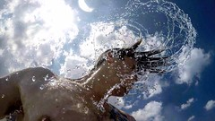 Water Spray (Cydney From Sydney) Tags: water blue ocean bali splash flick hair bare tattoo guy man sky cloud spray droplets skin sun bright clear gopro up holiday vacation summer indonesia asia happy fresh cool refreshing
