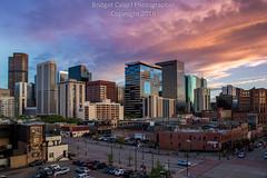 Lower Downtown Denver with Pink Sunset (Bridget Calip - Alluring Images) Tags: outdoor travel sunrise colorado skyline evening morning dusk denver copyrighted crime architecture sunset buildings skyscrapers exterior capitalcities marijuanalegal greentrees capitalofcolorado bridgetcalip centennialstate denverskyline alluringimages 5280abovesealevel queencity downtowndistrict blueskies milehicity dramaticclouds metalandglass vacationdestination denvercityandcountybuilding queencityoftheplains cityclouds capitalcity milehighcity highclouds cityscape alluringimagesllc buildingcomplex allrightsreserved rockymountains civiccenter batmanshooting denverbroncos