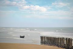 A lone boat (Bhaskar Dutta) Tags: single lone boat shore sea side sticks sky india digha